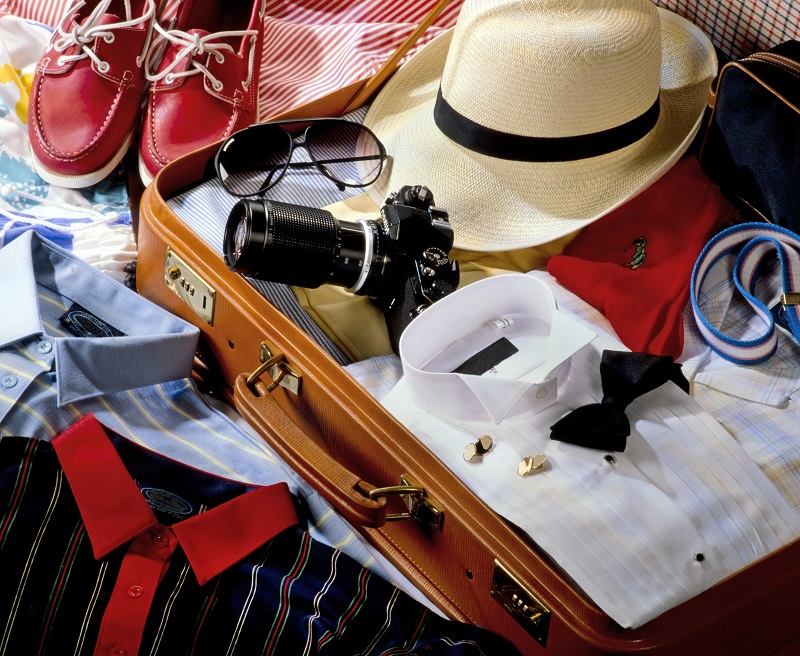 Men's open suitcase with clothes