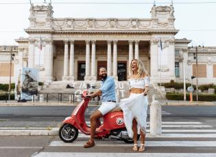 romantic holiday in Italy. Couple on vespa in Rome.