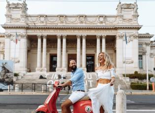 A couple on a scooter in front of the Galleria Nazionale in Rome.