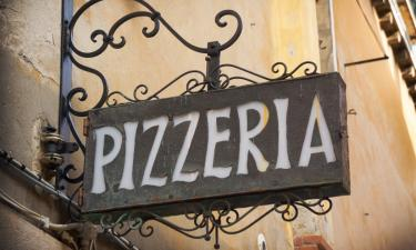 Pizzaria in Italy. Eating Pizza in Italy.