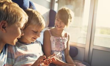 Children seated together on a train.